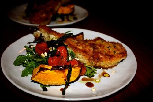 Parmesan & Sage Crumbed Pork Cutlets with Roast Pumpkin, Tomato & Rocket Salad
